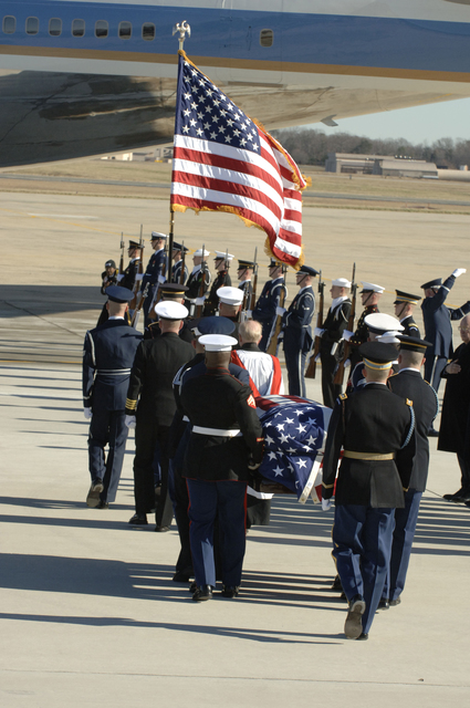 Members of the Ceremonial Honor Guard carry the casket of former President Gerald R. Ford, 38th President of the United States, during a final farewell to the former President at Andrews AFB, Md. The Fords will continue on to Grand Rapids, Michigan, the hometown of the former commander in chief. The grounds of the Gerald R. Ford Museum in Grand Rapids, Michigan will be the final place of internment for President Ford. (U.S. Air Force photo by TSgt Craig Clapper)