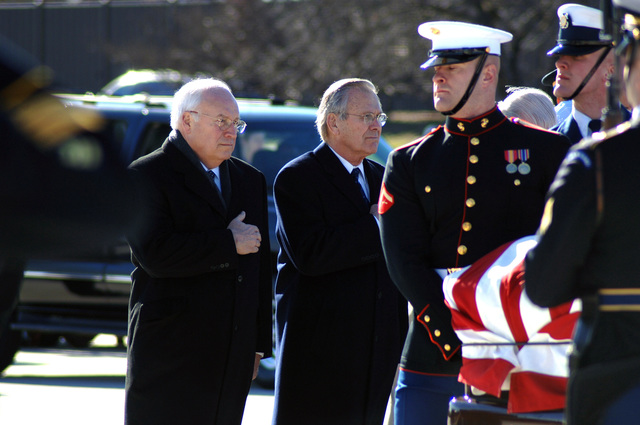 The Honorable Dick Cheney (left), Vice President of the United States, and former U.S. Secretary of Defense Donald H. Rumsfeld (right) both stand at attention and render final farewell honors as the U.S. military honor guard carries the casket holding the remains of former President Gerald R. Ford, 38th President of the United States, during a military departure ceremony at Andrews Air Force Base on Jan. 2, 2007. Former First Lady Mrs. Betty Ford will accompany her husband's body to Grand Rapids, Mich., President Ford's hometown, for final internment at the Gerald R. Ford Museum. (DoD photo by TECH. SGT. Christopher J. Matthews) (Released)