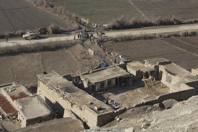 U.S. Army Soldiers from Bravo Company, 1ST Battalion, 102nd Infantry Regiment meet with villagers in Dingak, Afghanistan, Jan. 3, 2007, to gain information on possible enemy activity and weapons caches. (U.S. Army photo by STAFF SGT. Michael L. Casteel)  (Released)