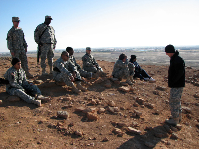 1ST LT. Benjamin Bender, U.S. Army, Chaplain assigned to Headquarters, Support Company, 449th Aviation Support Battalion, Texas Army National Guard, reflects for a few moments on bible history with Soldiers from the Battalion on top of the Ziggurat of Ur Pyramid during a Duty Day with God trip in Tallil, Iraq, on Jan.  4, 2007, during Operation Iraqi Freedom. (A3606) (U.S. Army PHOTO by SGT. 1ST Class Orbe) (Released)