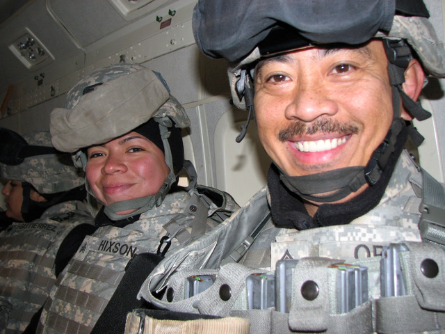 U.S. Army SGT.1ST Class Erwin Orbe (right) and SGT. Regina Hixon both assigned to Bravo Company, 449th Aviation Support Battalion, poses for a photograph together during a flight aboard a C-23B Sherpa aircraft, while enroute to Logistic Support Area, Adder, near An Nasiriyah, Iraq, on Jan.  4, 2007, during Operation Iraqi Freedom. (A3606) (U.S. Army PHOTO by SGT. 1ST Class Orbe) (Released)