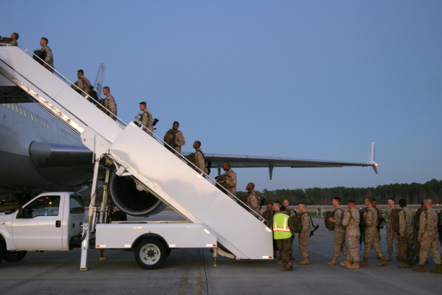 A U.S. Marine with Headquarters Company, Regimental Combat Team 6, I Marine Expeditionary Force board a plane on Camp Lejeune, N.C., Jan. 6, 2007, before deploying to Kuwait. (U.S. Marine Corps photo by CPL. Samuel D. Corum) (Released)