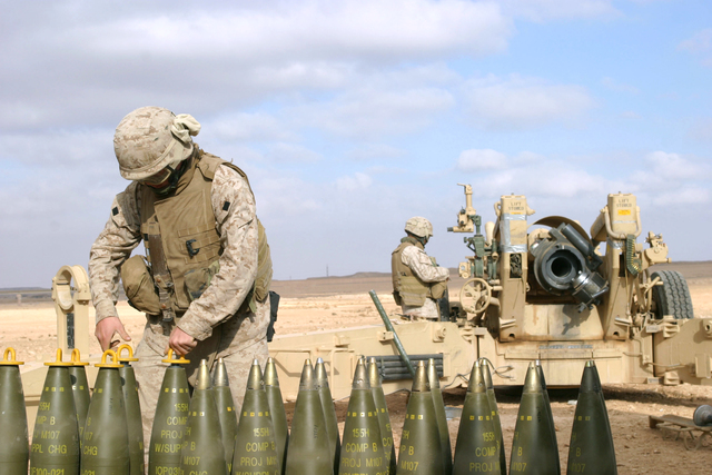 A U.S. Marine with Lima Battery, 2nd Battalion, 13th Marine Regiment prepare howitzer rounds to be fired near Baghdadi, Iraq, Jan. 6, 2007. (U.S. Marine Corps photo by SGT. Jacob E. Brewer) (Released)
