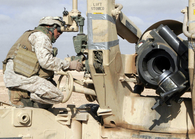 U.S. Marine Corps Lance CPL. Joseph Christian, with Lima Battery, 3rd Battalion, 12th Marine Regiment, 3rd Marine Division, adjusts a howitzer outside Camp Al Asad, Iraq, Jan. 6, 2007.  (U.S. Marine Corps photo by Lance CPL. Tyler W. Hill) (Released)
