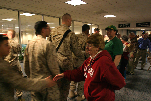 U.S. Marines with Headquarters Company, Regimental Combat Team 6, I Marine Expeditionary Force arrive at the Bangor, Maine, airport, Jan. 6, 2007, during a layover before deploying to Kuwait. (U.S. Marine Corps photo by CPL. Samuel D. Corum) (Released)