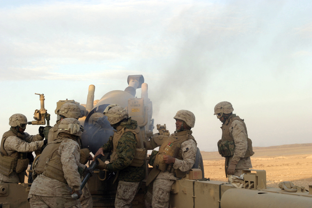 U.S. Marines with Lima Battery, 2nd Battalion, 13th Marine Regiment fire a howitzer near Baghdadi, Iraq, Jan. 6, 2007. (U.S. Marine Corps photo by SGT. Jacob E. Brewer) (Released)