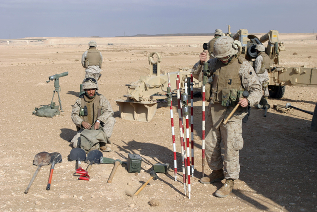 U.S. Marines with Lima Battery, 2nd Battalion, 13th Marine Regiment prepare to fire a howitzer near Baghdadi, Iraq, Jan. 6, 2007. (U.S. Marine Corps photo by SGT. Jacob E. Brewer) (Released)