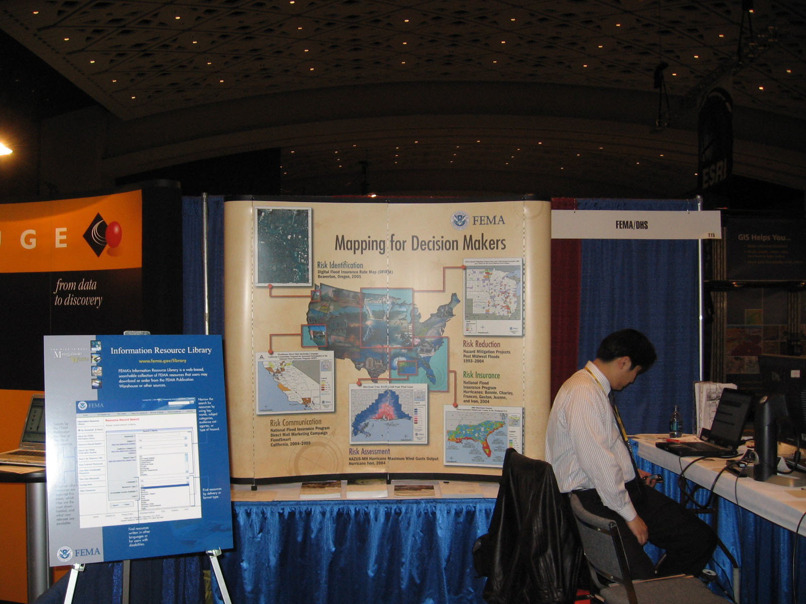Paul Huang of FEMA's Map Service Center (MSC) researches information for visitors to FEMA's booth during the ESRI Federal User Conference in January 2007. Photo by Eugene Luke/FEMA.