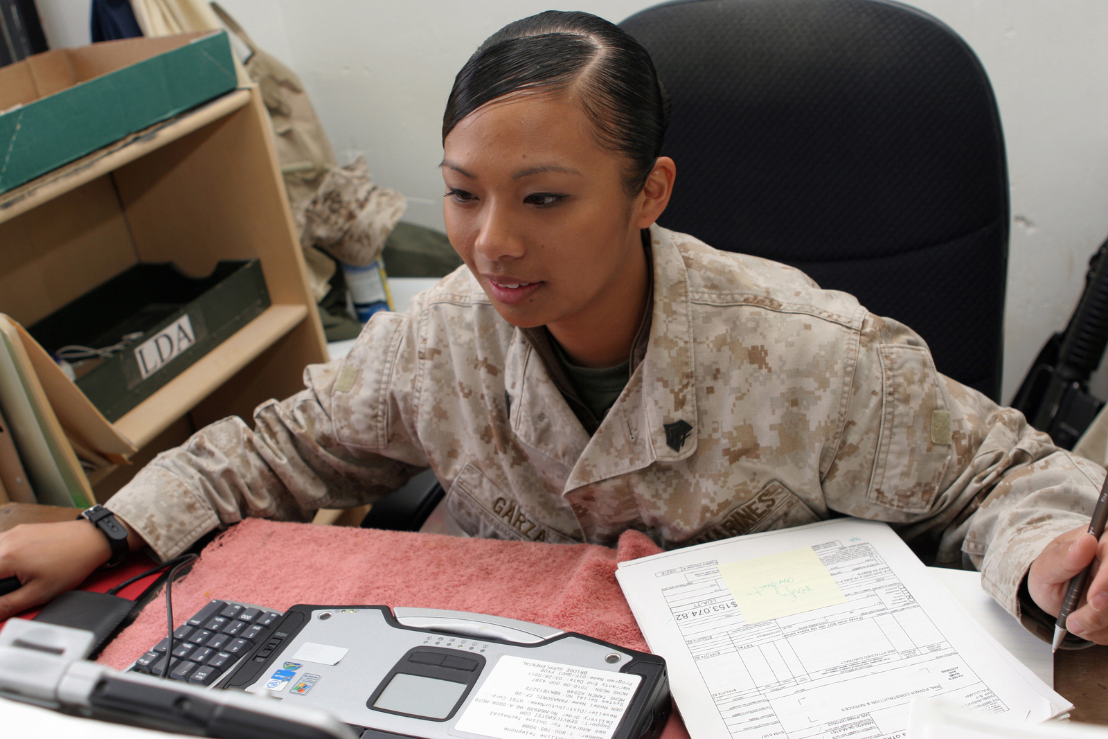 Michelle Garza, A Fiscal Chief With Combat Logistics Regiment 17, 1ST  Marine Logistics Group (Forward), Processes Contracts At Disbursing Office  At Camp Al ...