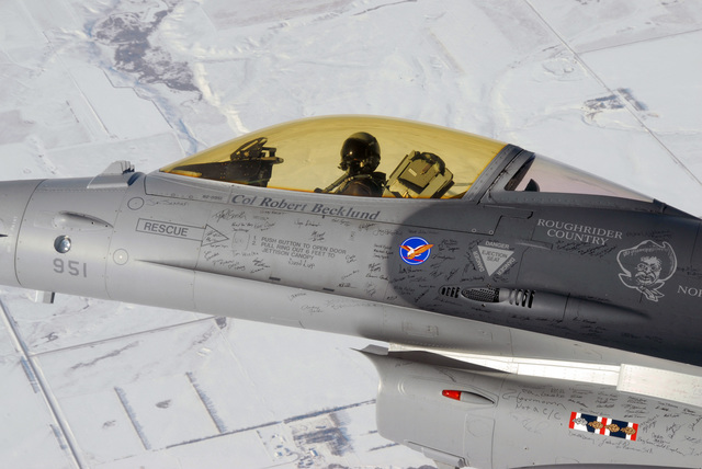 """U.S. Air Force COL. Robert J. Becklund, Commander, 119th Fighter Wing (FW), flies an F-16 Fighting Falcon to the Aerospace Maintenance and Regeneration Center, nicknamed the""""boneyard,""""Tucson, Ariz., Jan. 16, 2007. This final flight is part of a 60th Anniversary Celebration of the North Dakota Air National Guard and the send-off of the Falcon. The 119th FW is transitioning from the F-16 to the C-21 Learjet to support a new mission. (U.S. Air Force photo by SENIOR MASTER SGT. David H. Lipp) (Released)"""