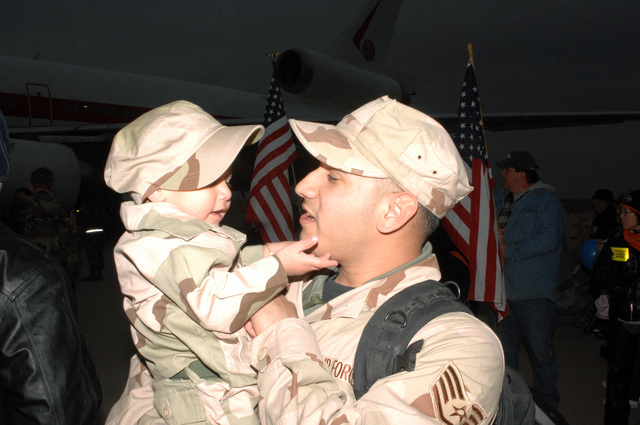 U.S. Air Force STAFF SGT. Louis DeWitt, Aircraft Maintenance Squadron, 27th Fighter Wing, is welcomed home by his son at Cannon Air Force Base, N.M., Jan. 18, 2007, after returning home from a deployment to Iraq as part of the Aerospace Expeditionary Force 3/4 rotation. (U.S. Air Force photo by AIRMAN 1ST Class Randi Flaugh) (Released)