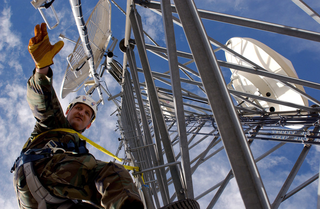 U.S. Air Force TECH. SGT. Mark Quinn, 142nd Fighter Wing (FW), Oregon Air National Guard (ORANG), Ore., performs an inspection survey on a communications tower near Tucson, Ariz., Jan. 18, 2007.  The 142nd FW is deployed in support of Operation Jump Start, an operation including more than 6,000 U.S. Army National Guardsmen and U.S. Air Force Air National Guardsmen from around the nation working in partnership with the U.S. Customs and Border Patrol to help secure the southern border.  (U.S. Air Force photo by SENIOR AIRMAN Trisha Harris) (Released)