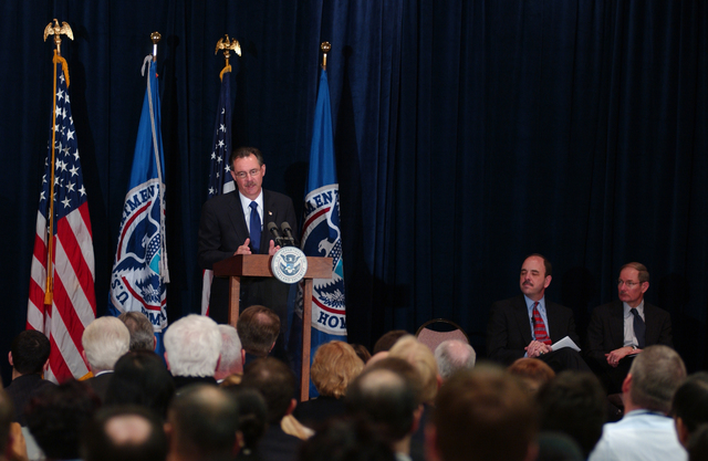 Washington, DC, January 22, 2007 -- R. David Paulison outlines the reorganization of FEMA at the podium during an all hands meeting at FEMA headquarters. Mr. Paulison takes the new title of Administrator of FEMA. FEMA will consist (on March 31, 2007) of The United States Fire Administration (USFA), The Office of Grants and Training (G&T), The Chemical Stockpile Emergency Preparedness Division (CSEP), The Radiological Emergency Preparedness Program (REPP) and the Office of National Capital Region Coordination (NCRC) as mandated by the Post-Katrina Emergency Management Act. On the stage behind him are Under Secretary George Foresman and Deputy Administrator Harvey Johnson. FEMA/Bill Koplitz