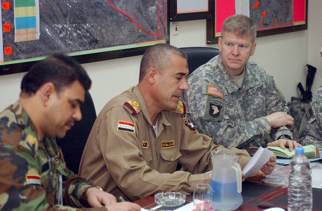 Brig. GEN. Abd-Al Karim (center), Commander, 7th Brigade, 2nd Iraqi National Police Division, speaks during a meeting with U.S. Army LT. COL. George Glaze (right), Commander, Task Force 1-18, 2nd Brigade Combat Team, 1ST Infantry Division, and other local commanders on Jan. 24, 2007, in Al Bayaa, Baghdad Province, Iraq, to work out combined operations in the area.  (U.S. Army photo by STAFF SGT. Martin K. Newton) (Released)