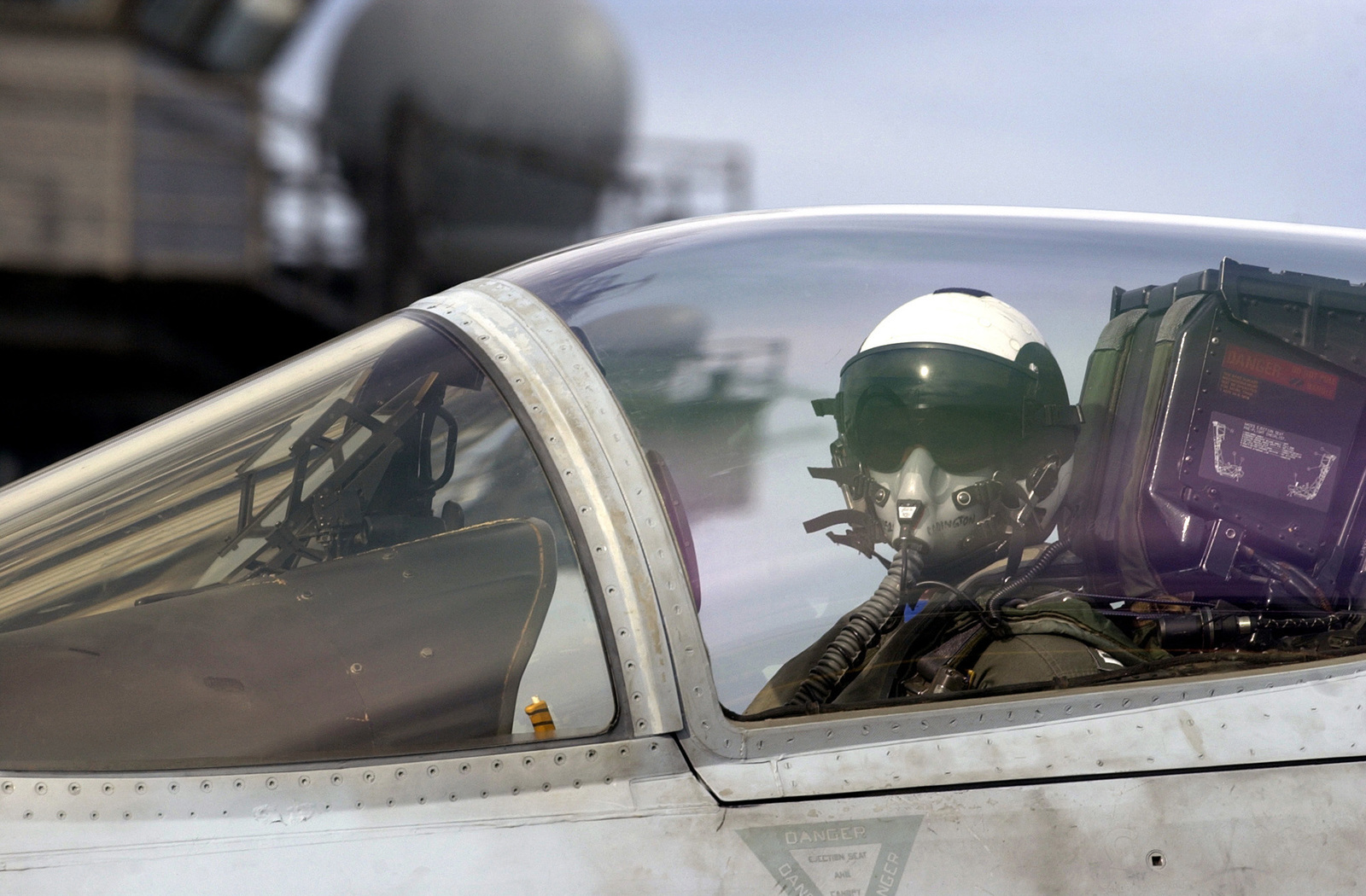 """A U.S. Navy Strike Fighter Squadron 113 (VFA-113,""""Stingers"""") pilot watches the hand signals of an aircraft handler as he is directed to taxi his F/A-18E Super Hornet multi-mission fighter/attack aircraft into launch position before taking off from the flight deck of the Nimitz Class Aircraft Carrier USS RONALD REAGAN (CVN 76) on Jan. 28, 2007, while the REAGAN and its strike group are currently underway on a surge deployment in support of U.S. military operations in the western Pacific Ocean. (U.S. Navy photo by Mass Communication SPECIALIST 2nd Class Aaron Burden) (Released)"""
