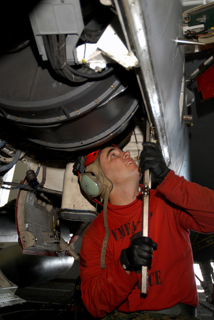 """U.S. Marine Corps CPL. Ryan Daggs, Marine Strike Fighter Squadron 323 (VMFA-323,""""Death Rattlers""""), prepares to remove the 20 mm gun turret from an F/A-18C Hornet strike fighter aircraft in the hangar bay aboard the Nimitz Class Aircraft Carrier USS JOHN C. STENNIS (CVN 74) on Jan. 29, 2007, while the STENNIS and Carrier Air Wing 9 (CVW-9) are conducting carrier qualifications of the coast of Southern California prior to transiting west to bolster security in the U.S. Central Command Area of Operations. (U.S. Navy photo by Mass Communication SPECIALIST SEAMAN John Wagner) (Released)"""