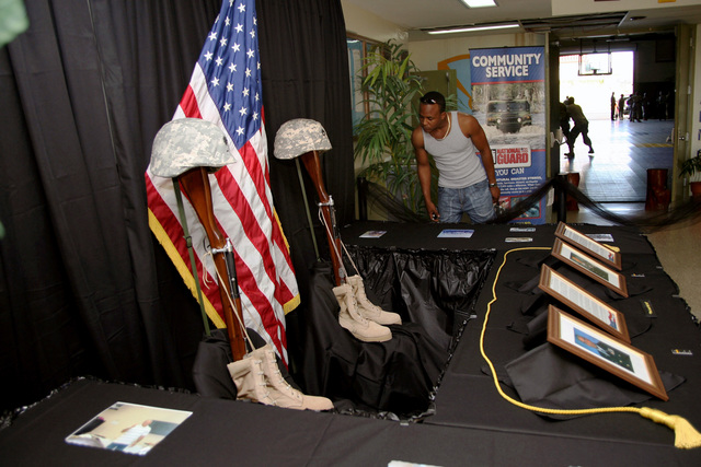 A Memorial tribute to U.S. Army LT. COL. David C. Canegata and SGT 1ST Class Lakes on Jan. 31, 2007, at the LT. COL. Lionel A. Jackson Armory, 104th Troop Command, United States Virgin Island National Guard Armory, United States Virgin Islands, who lost their lives in support of Operation Enduring Freedom. (U.S. Army photo by Joseph Bonet) (Released)