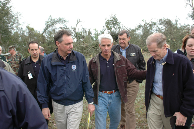 [Severe Storms and Tornadoes] Lady Lake, Fla., February 3, 2007 -- FEMA Director David Paulison (in FEMA jacket) and (l to r), Florida Governor Charlie Crist and U.S. Senators Mel Martinez (R-FL) and Bill Nelson (D-FL) discuss the response effort being initiated by FEMA.  Central Florida was hit with one or more tornadoes overnight causing severe damage and several deaths.  Mark Wolfe/FEMA