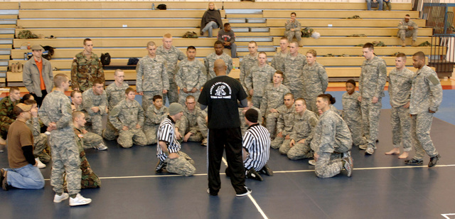 U.S. Army SGT. 1ST Class Brian Sarjeant (foreground, center, standing) goes over the rules, regulations and safety precautions to the competitors at the Combative Tournament at Aberdeen Proving Grounds, Md., on Feb. 3, 2007.  (U.S. Army photo by PVT. 1ST Class Tiffany Dusterhoft) (Released)
