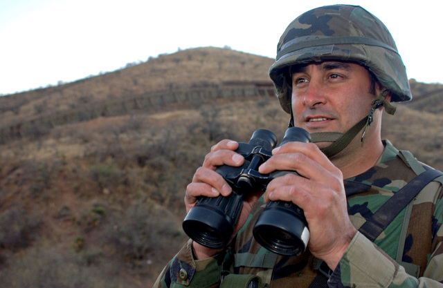 U.S. Air Force SENIOR Airmen Dion Rives, 142nd Fighter Wing (FW), Oregon Air National Guard (ORANG), Ore., monitors the Arizona-Mexico border for illegal activity near Nogales, Ariz., Feb. 4, 2007.  Rives is attached to the entry identification team in support of Operation Jump Start, an operation including more than 6,000 U.S. Army National Guardsmen and U.S. Air Force Air National Guardsmen from around the nation working in partnership with the U.S. Customs and Border Patrol to help secure the southern border.  (U.S. Air Force photo by SENIOR AIRMAN Trisha Harris) (Released)