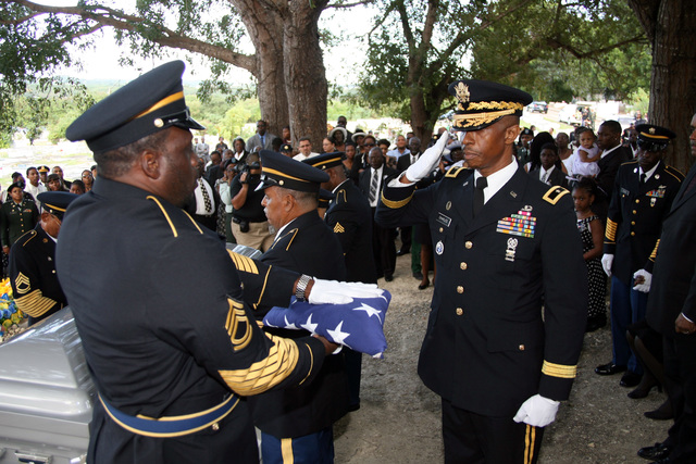 U.S. Army Brig. GEN. Eddy L. Charles (right), Adjutant General of the U.S. Virgin Island National Guard, salutes the folded flag that draped the casket of U.S. Army SGT. 1ST Class Everett L. Lake, Sr., at the Kingshill Veterans Cemetery on Feb. 4, 2007, in the U.S. Virgin Islands.  (U.S. Army photo by Joseph Bonet) (Released)