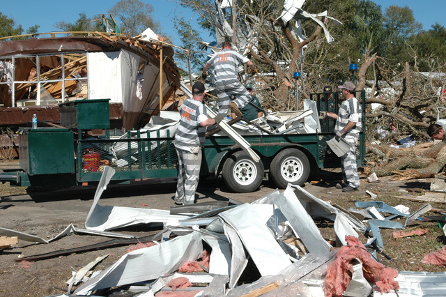 [Severe Storms and Tornadoes] Lady Lake, Fla., February 6, 2007 -- Inmates from the Lake County Jail help with the clean up from the recent central Florida tornadoes.  The clean up process began quickly after the tornadoes struck.  Mark Wolfe/FEMA