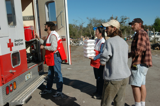 [Severe Storms and Tornadoes] Lady Lake, Fla., February 6, 2007 -- The American Red Cross hands out meals to residents affected by the recent tornadoes.  The tornadoes caused extensive damage to the Lady Lake area.  Mark Wolfe/FEMA