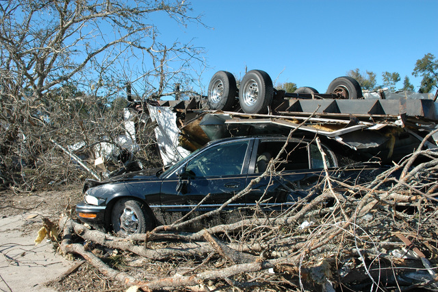 [Severe Storms and Tornadoes] Lady Lake, Fla., February 6, 2007 -- The recent tornadoes took this manufactured home into the air and put it on this car.  Tornadoes are very powerful and destructive forces.  Mark Wolfe/FEMA