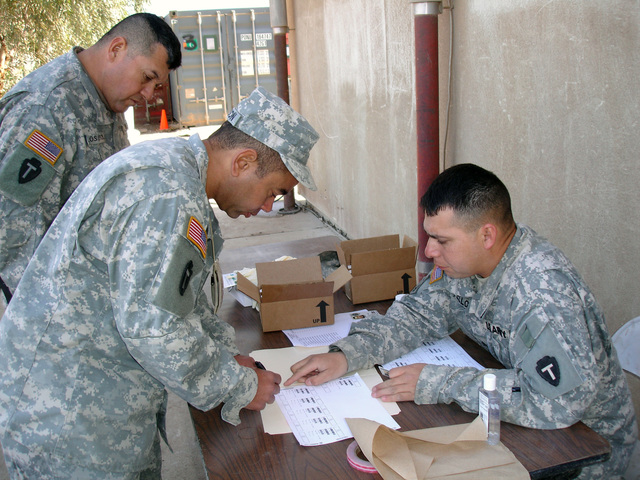 U.S. Army SGT 1ST Class Willie Jamison (foreground, left), STAFF SGT. David Delossantos (rear, left) and SGT. Nickolas Tello, all from Headquarters Support Company, 449th Aviation Support Battalion, Texas Army National Guard (TXARNG), participate in the mandatory drug testing program at Logistical Support Area (LSA) Anaconda, Baghdad Province, Iraq, Feb. 8, 2007.  (A3606) (U.S. Army photo by SGT. Huey Kehl) (Released)