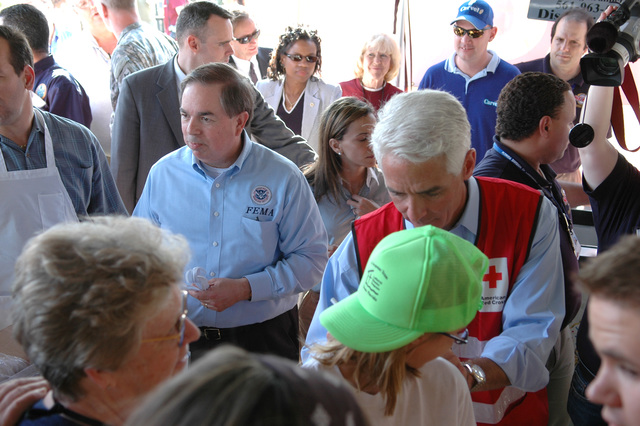 [Severe Storms and Tornadoes] Lady Lake, FL, February 12, 2007 -- FEMA Federal Coordinating Officer Jesse Munoz (center, left) passes out ice cream along with Florida Governor Charlie Crist (Red Cross vest) at a volunteer recognition event today in Lady Lake.  Volunteers are an important part of the recovery process from disasters.  Mark Wolfe/FEMA