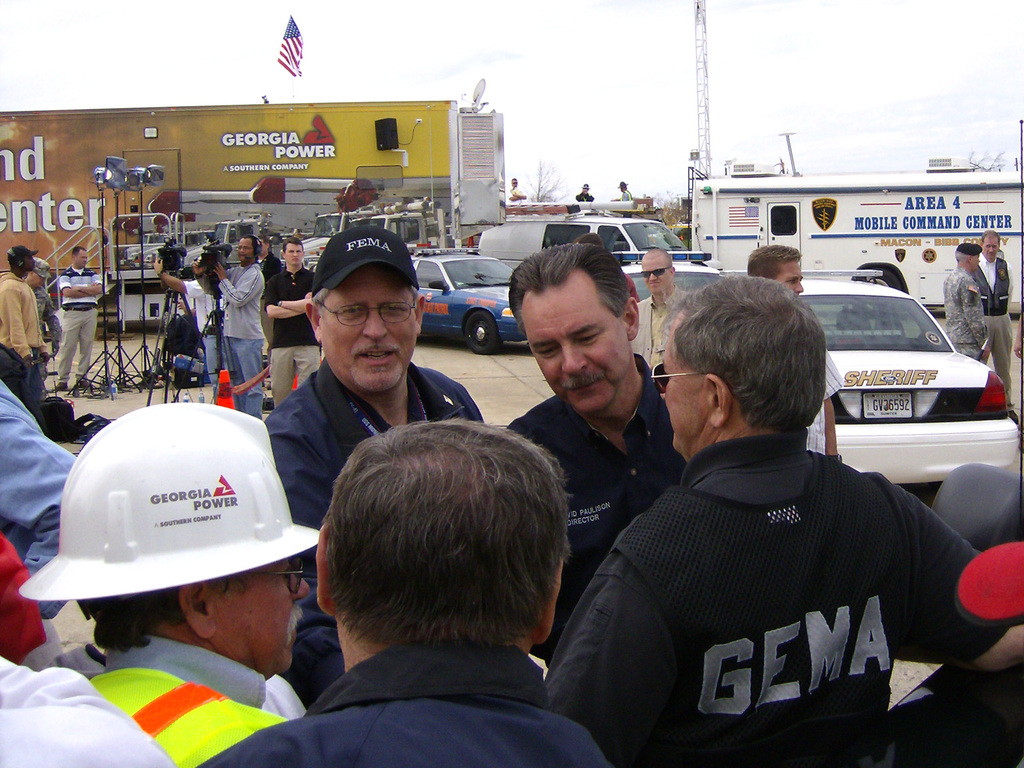 [Severe Storms and Tornadoes] Americus, GA, March 3, 2007 -- FEMA Director David Paulison (center) and Federal Coordinating Officer (FCO) Michael Bolch (in FEMA hat) during a visit to Americus to personally view the damage that occurred due to tornadoes. The tornadoes hit during the afternoon and evening of March 1.  Hope Bresch/FEMA