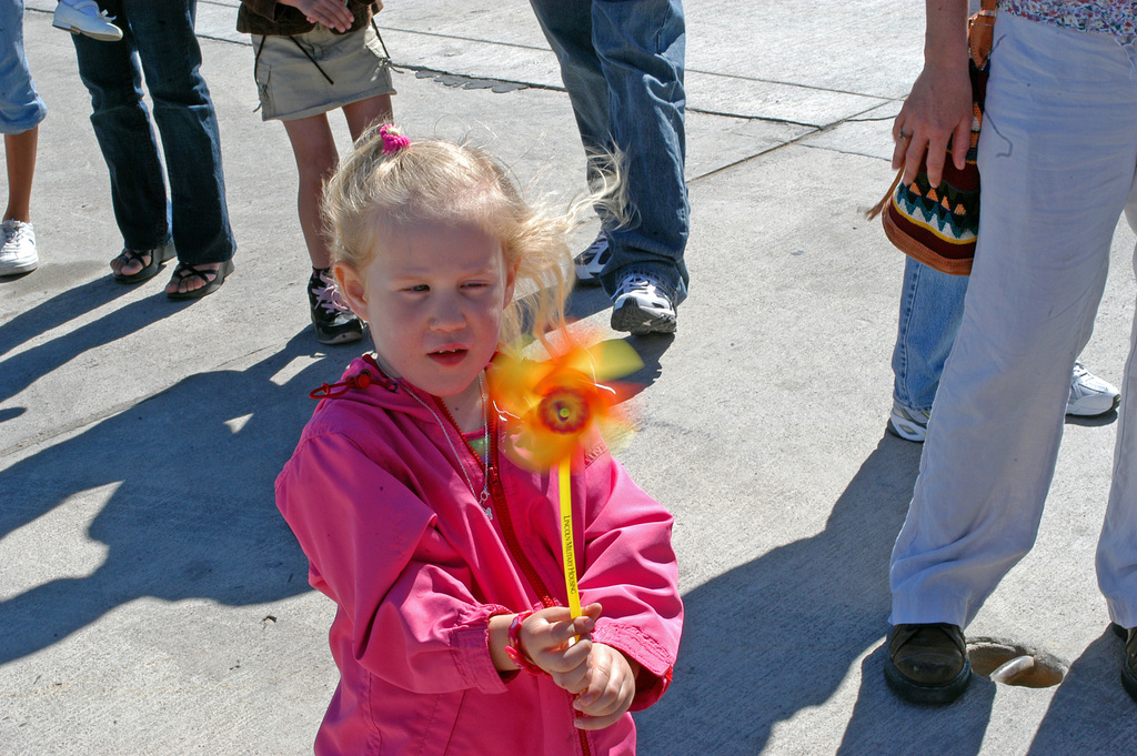 Trinity Petrokovitch, age 3, daughter of STAFF SGT. Roberta Petrokovitch, Headquarters and Headquarters Squadron, plays with a windmill toy that she acquired while exploring the many displays at the 2007 Marine Corps Air Station Yuma Air Show on Feb. 24, 2007.(U.S. Marine Corps PHOTO by CPL. Annette Spurgeon) (Released)
