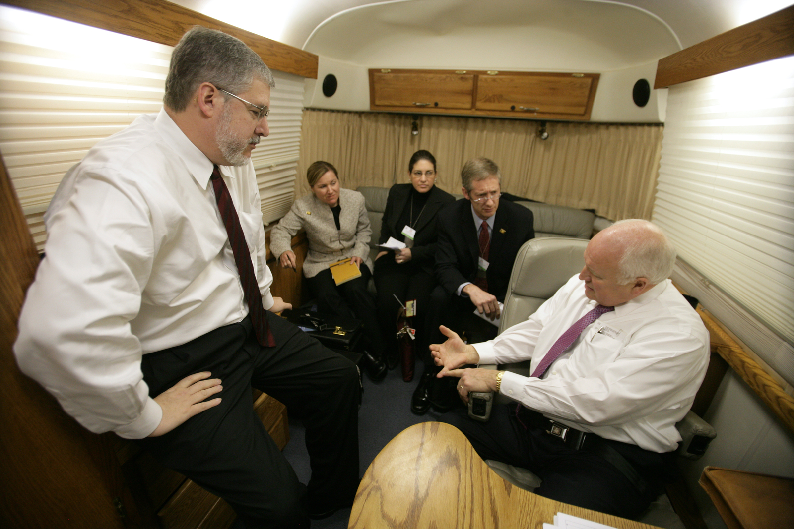 "Vice President Cheney, David Addington, CIA Deputy Director Stephen Kappes, and Vice Presidential Staff Aboard C-17 Aircraft in the ""Silver Bullet"" Stateroom"