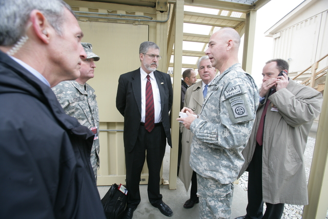 David Addington and Vice Presidential Staff Talk With Military Personnel and Secret Service Agents After Suicide Bomber Attack at Bagram Air Base Gate