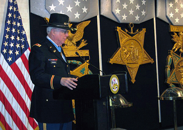LT. COL. Bruce Crandall (U.S. Army, ret.) speaks during his induction into the Pentagon's Hall of Heroes on Feb. 27, 2007, the day after President George W. Bush awarded him the Medal of Honor for his heroism as a U.S. Army 1ST Cavalry Division helicopter flight commander during the Vietnam War in November 1965. (DoD photo by Eric Draper, CIV) (Released)