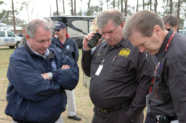 [Severe Storms and Tornadoes] Enterprise, AL, March 3, 2007 -- FEMA Region IV Director Phil May (left) listens with Alabama EMA officials to a status report via speaker phone concerning the response to the recent tornadoes. FEMA and AEMA began their initial response to the disaster immediately. Mark Wolfe/FEMA