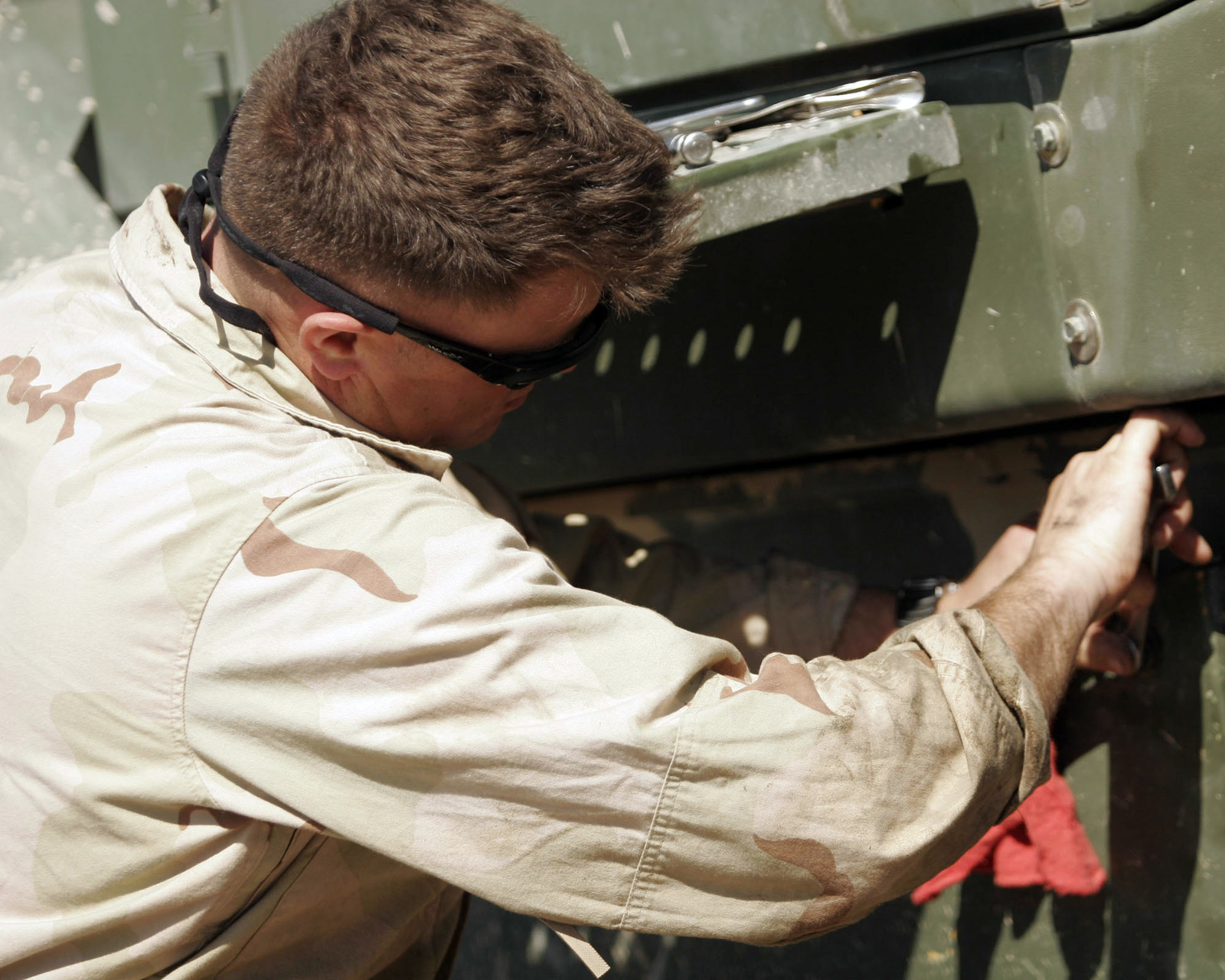 SGT. Jamie B. Pugh, Conbat Logistics Battalion 6 Transport Support Conpany Platoon SGT., screws in a cover onto a 644 E Tram, during an operational check in the Maintenance lot on March 6, 2007. Conbat Logistics Battalion 6 is deployed within the Anbar province in order to develop the Iraqi Security Forces, facilitate the development of rule of law through democratic government reforms and continue the development of a market based econony centered on Iraqi reconstruction. (U.S. Marine Corps photo by CPL. Michael J. O'Brien) (Released)
