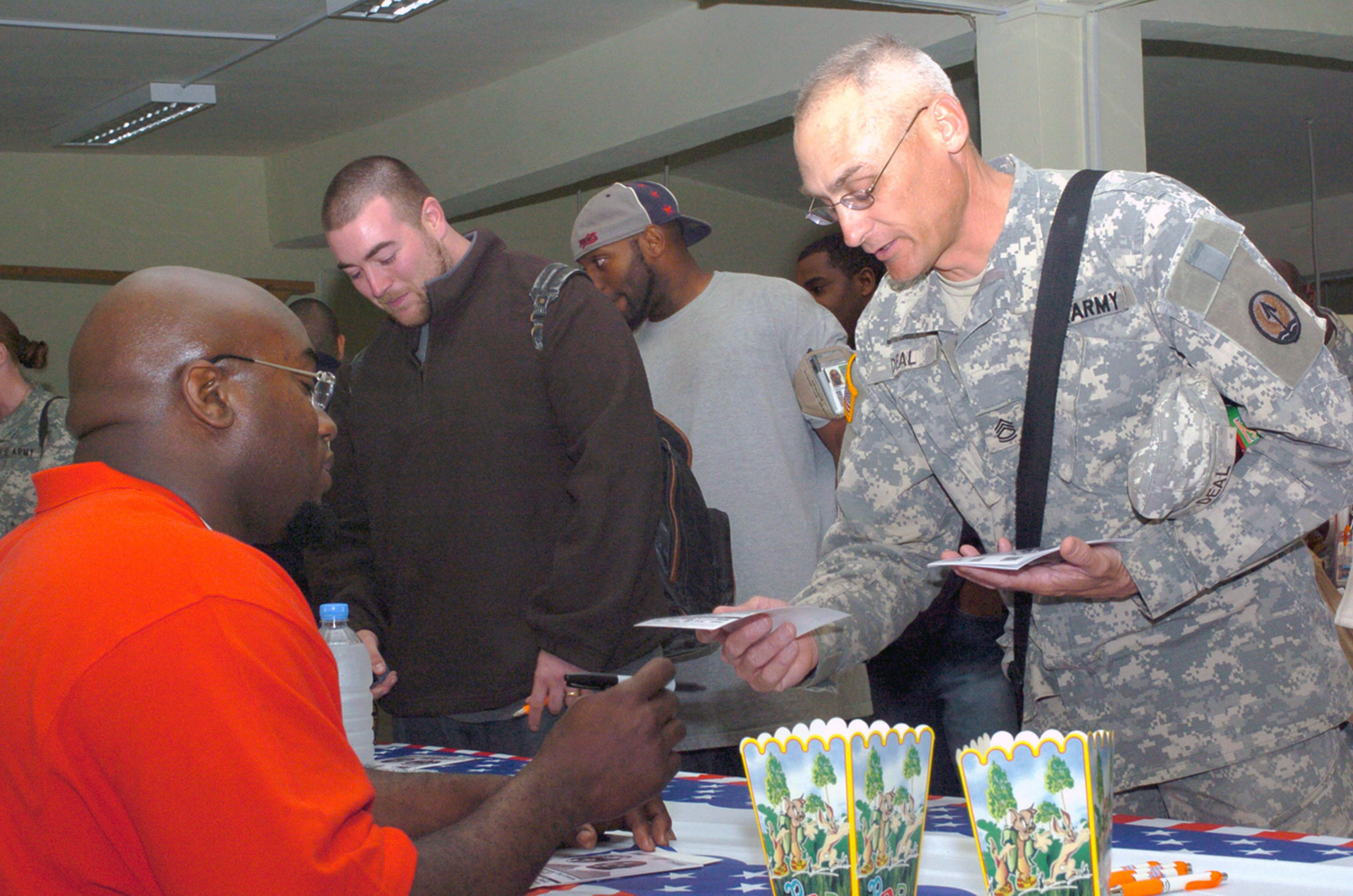 U.S. Army SGT. 1ST Class James Deal (right), 3rd Infantry Division, chats with Kansas City CHIEF's Football Player Will Shields (left) on March 6, 2007, at Camp Victory, Salah ad Din Province, Iraq, during Operation Iraqi Freedom.  (U.S. Army photo by Laura M. Bigenho) (Released)