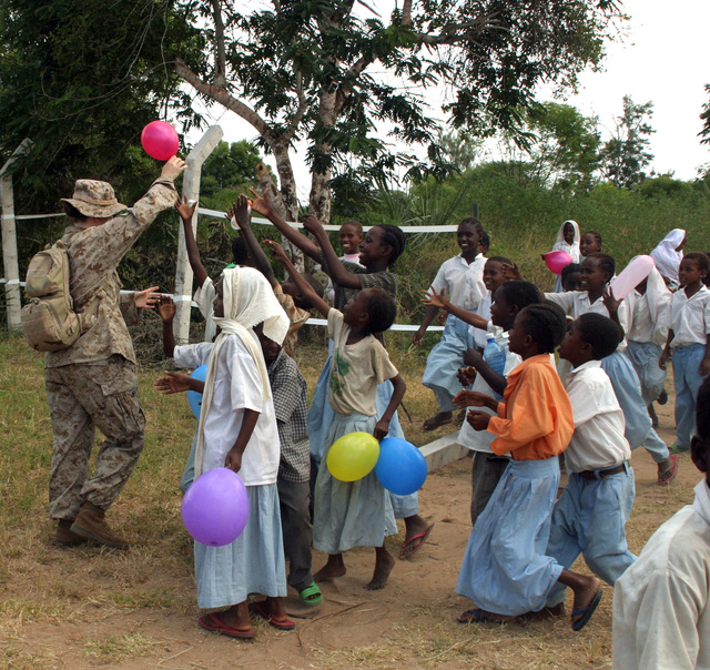 Hospital Corpsman st Class Tara C. Beatty, 26th Marine Expeditionary Unit, plays with children at the site of the Medical Civil Assistance Project and Bargoni Primary School refurbishment project March 7, 2007, during Exercise Edged Mallet.  The 26th MEU is conducting bilateral training and community relations projects with the Kenyan armed forces during Exercise Edged Mallet 2007. (U.S. Marine Corps photo by Lance CPL. Patrick M. Johnson-Campbell) (Released)