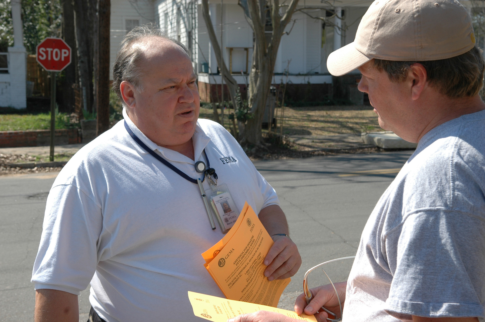 [Severe Storms and Tornadoes] Americus, GA, March 8, 2007 -- FEMA Community Relations (CR) representative Mickey DePaolo speaks with a resident affected by the Georgia tornadoes.  CR personnel go door to door to educate residents about  FEMA programs.  Mark Wolfe/FEMA
