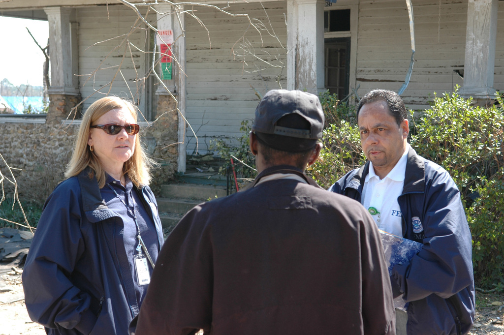 [Severe Storms and Tornadoes] Americus, GA, March 8, 2007 -- FEMA Community Relations (CR) representatives Jill Harper (left) and Nelson Andrews speak with a resident whose home has been deemed unlivable by local authorities.  The resident's home was severely damaged by the Georgia tornadoes.  Mark Wolfe/FEMA