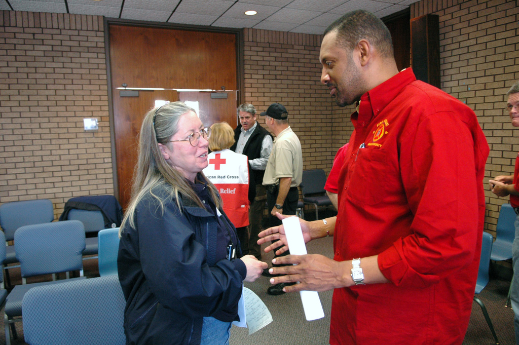 [Severe Storms and Tornadoes] Americus, GA, March 8, 2007 --  FEMA Public Information Officer (PIO) Rita Egan (left) speaks with Vernon Jones Dekalb County, Ga. CEO.  Mr. Jones has provided Dekalb County resources to Americus to help with the recovery from the Georgia tornadoes.  Mark Wolfe/FEMA