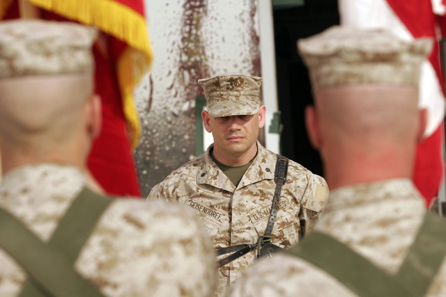U.S. Marine Corps LT. COL. Tyson B. Geisendorff, Combat Logistics Battalion 2 Commanding Officer, stands at attention as the Colors for Combat Logistics Battalion 2 are presented during the Transfer of Authority Ceremony, in which Combat Logistics Battalion is turning over command to Combat Logistics Battalion 2 on March 8, 2007. Combat Logistics Battalion 2 is deployed within the Anbar province in order to develop the Iraqi Security Forces, facilitate the development of rule of law through democratic government reforms and continue the development of a market based economy centered on Iraqi reconstruction. (U.S. Marine Corps photo by CPL. Michael J. O'Brien) (Released)