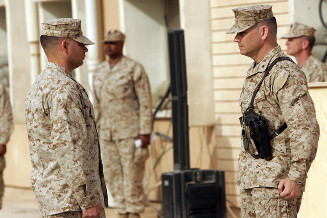 U.S. Marine Corps LT. COL. Tyson B. Geisendorff, Combat Logistics Battalion 2 Commanding Officer, stands at attention during the retiring of the Colors during the Transfer of Authority Ceremony, in which Combat Logistics Battalion is turning over command to Combat Logistics Battalion 2 on March 8, 2007. Combat Logistics Battalion 2 is deployed within the Anbar province in order to develop the Iraqi Security Forces, facilitate the development of rule of law through democratic government reforms and continue the development of a market based economy centered on Iraqi reconstruction. (U.S. Marine Corps photo by CPL. Michael J. O'Brien) (Released)