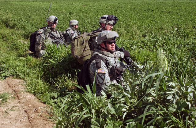 U.S. Army Soldiers, Apache Company, 1ST Battalion, 23rd Infantry Regiment, 2nd Infantry Division, take a break in a field in Mahmudiyah, Al Anbar Province, Iraq, on March 9, 2007, while tracking down possible insurgent activities during Operation Iraqi Freedom.  (U.S. Army photo by Elisha Dawkins) (Released)