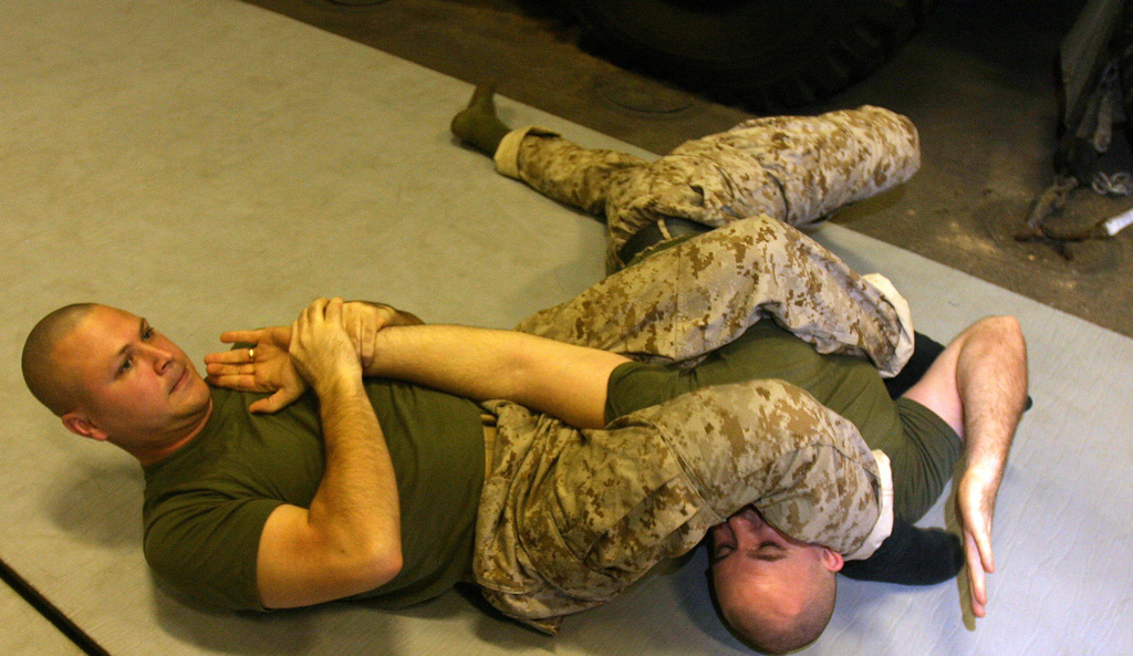 U.S. Marines of the 26th Marine Expeditionary Unit Command Element are testing to receive their green belt in the Marine Corps Martial Arts Program aboard USS BATAAN (LHD 5) on March 5, 2007. (U.S. Marine Corps photo by STAFF SGT. Trent Kinsey) (Released)