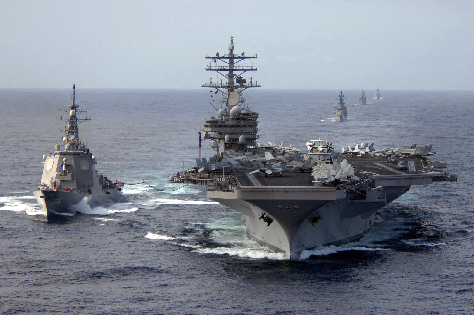 The U.S. Navy Nimitz Class Aircraft Carrier USS RONALD REAGAN (CVN 76) (right) connects to the Japanese Maritime Self Defense Force (JMSDF) Kongo Class Destroyer MYOKO (DDG 175) during a refueling at sea evolution somewhere in the Pacific Ocean, Mar. 17, 2007.  The Ronald Reagan Carrier Strike Group (RRCSG) is on a surge deployment in support of U.S. Military operations in the Western Pacific.  (U.S. Navy photo by CHIEF Mass Communication SPECIALIST Spike Call) (Released)