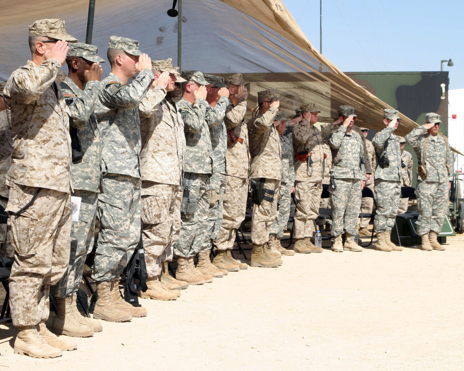 March 9, 2007, Service members in attendance salute during the playing of the National Anthem at the end of the Multi- National Force Hospital Ribbon Cutting Ceremony on Asad Air Base, Iraq. Task Force 3 3rd Medical Command is deployed as a part of MNF-W in support of Operation Iraqi Freedom in the Anbar province of Iraq to develop the Iraqi Security Forces, facilitate the development of official rule of law through democratic government reforms and continue the development of a market based economy centered on Iraqi reconstruction. (Official USMC photograph by SGT Andrew D. Pendracki) (Released)