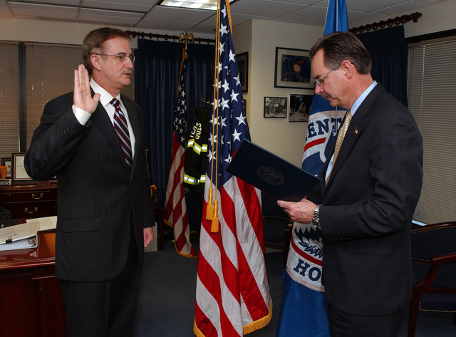 Washington, DC, March 19, 2007 -- FEMA Director R. David Paulison swears in Jonathan Sarubbi as the FEMA Region 3 Director in Mr. Paulison's office at FEMA Headquarters.  The new Region 3 Director, Jonathan Sarubbi, fills the last open Regional Director slot.  FEMA/Bill Koplitz