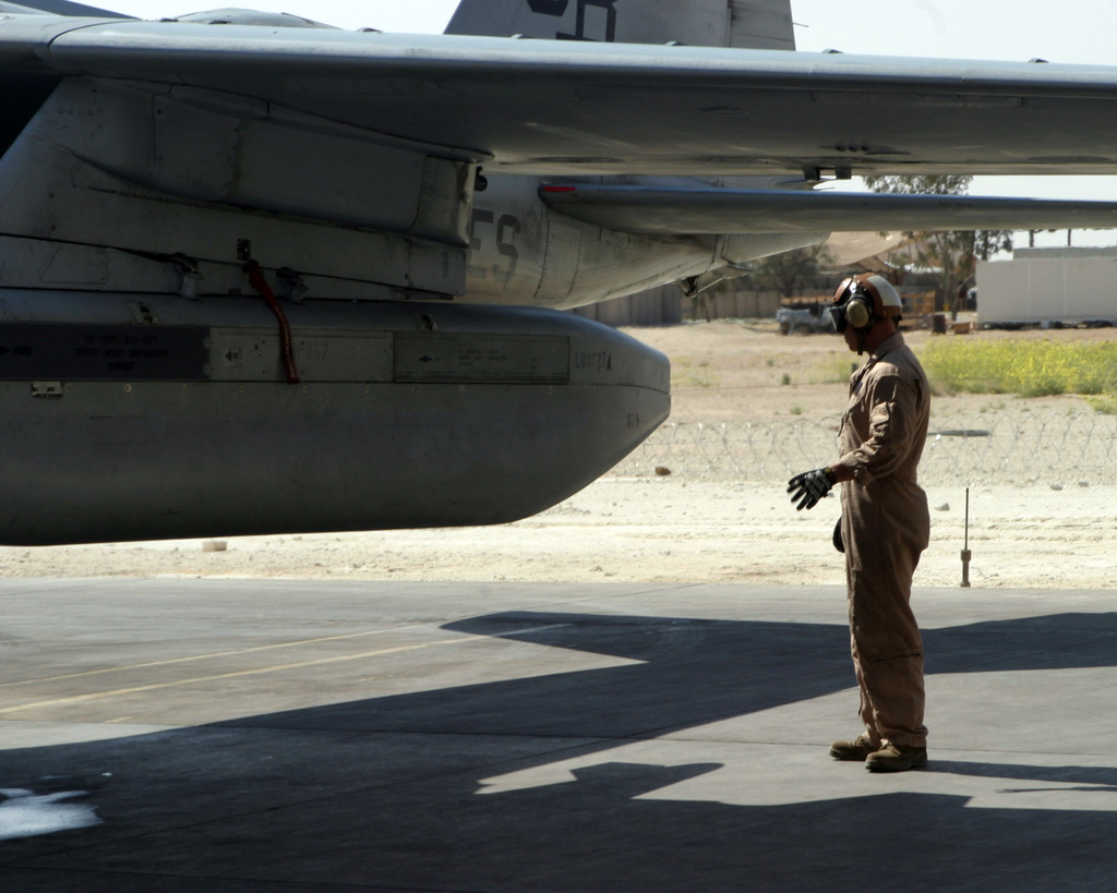 March 20, 2007,  CPL. Joshua Gomez, an engine mechanic with Marine Tactical Electronic Warfare Squadron  (VMAQ-1), point checks an EA-6B Prowler before it launches out of Asad Air Base, Iraq.  VMAQ-1 is deployed as a part of MNF-W in support of Operation Iraqi Freedom in the Anbar province of Iraq to develop the Iraqi Security Forces, facilitate the development of official rule of law through democratic reforms and continue the development of a market based economy centered on Iraqi reconstruction. (U.S. Marine Corps photo by Lance CPL. Michael L. Haas) (Released)